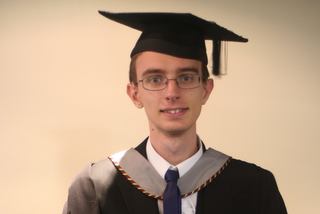 Tim in his official rental gown and mortarboard