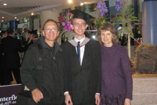 Tim with his proud parents after graduation