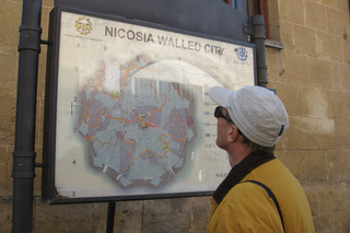 Richard studying a map on the wall