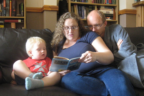Daniel, Becky and David enjoying a 'Thomas the Tank Engine' book